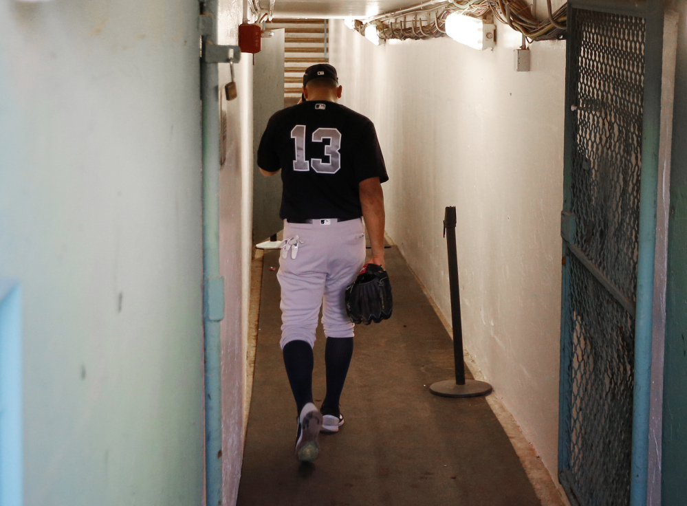 New York Yankees infielder Alex Rodriguez walks back down the tunnel to the clubhouse before the team's game against the Red Sox at Fenway Park in Boston on Tuesday.