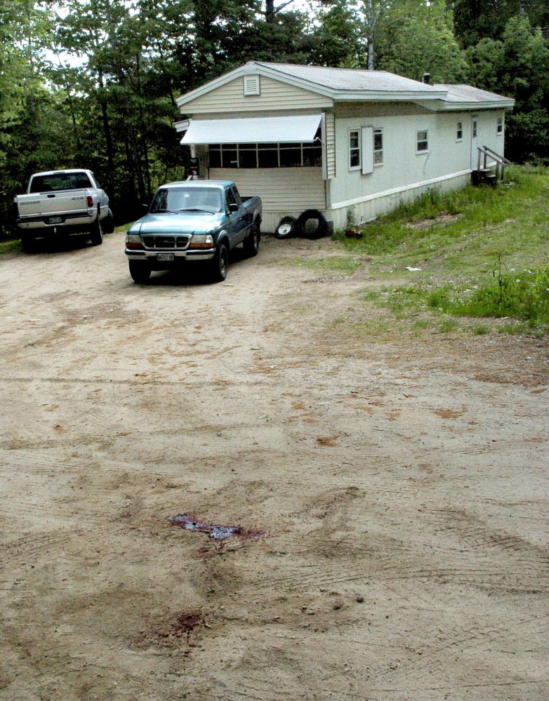 A pool of blood marks a driveway at 259 Weld Road in Wilton, where Michael Reis of New Sharon was killed June 1.