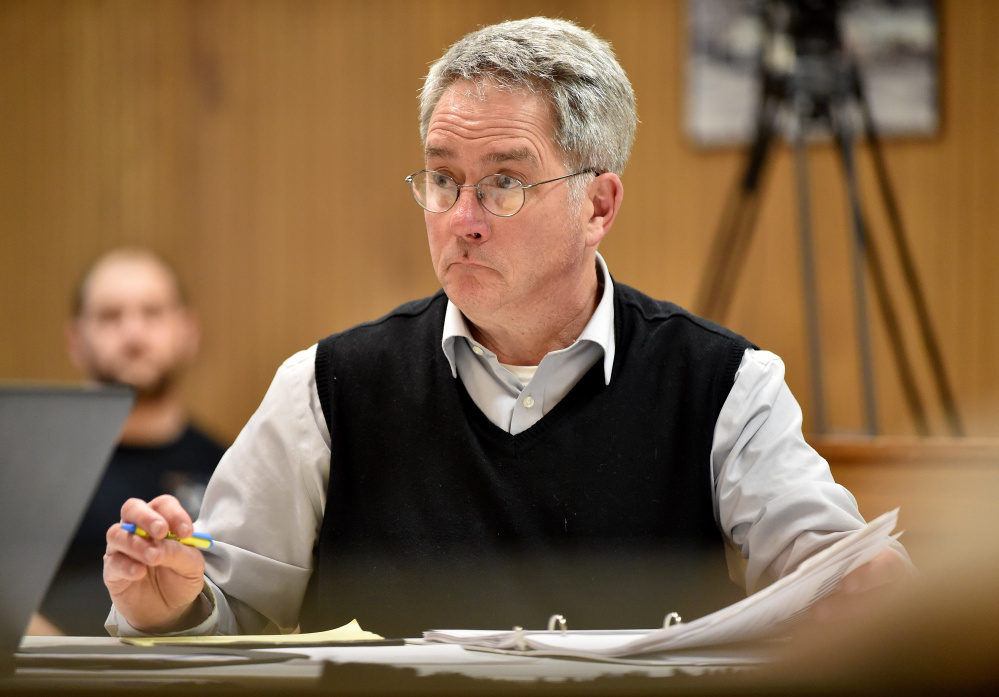 Councilor John O'Donnell listens during a review of budgets in March.