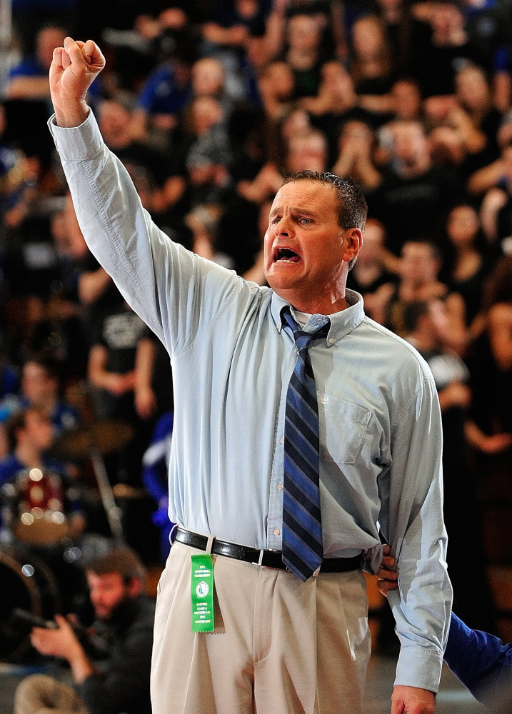 Lawrence coach Mike McGee calls instructions to his players during the Eastern A tournament championship game on Feb. 22, 2013 at the Augusta Civic Center.