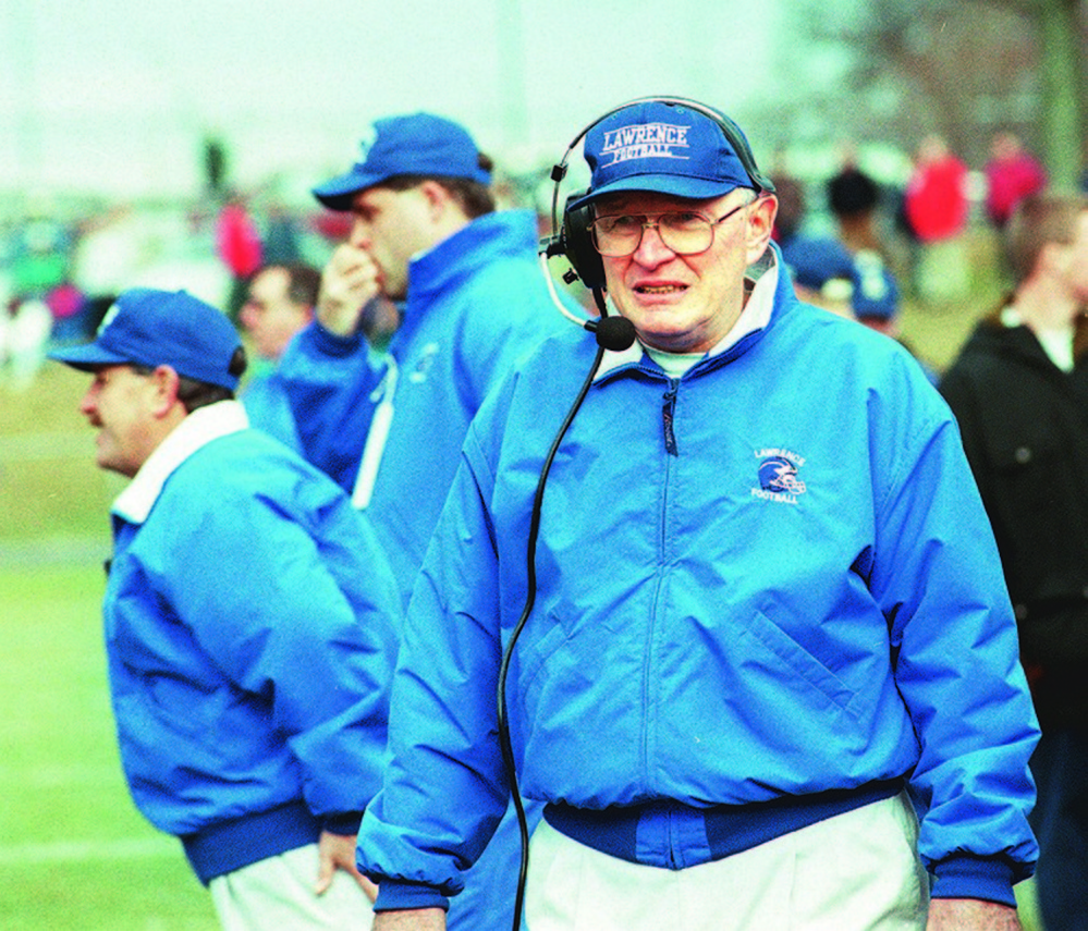 Lawrence coach Pete Cooper, front, watches the action during the 1996 Class A state championship game against South Portland.