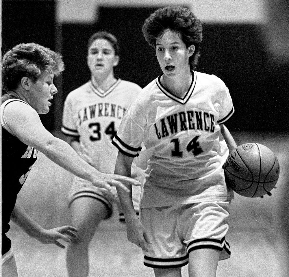 Lawrence High School standout Cindy Blodgett takes the ball up the court during a Dec. 3, 1993 game against Nokomis.
