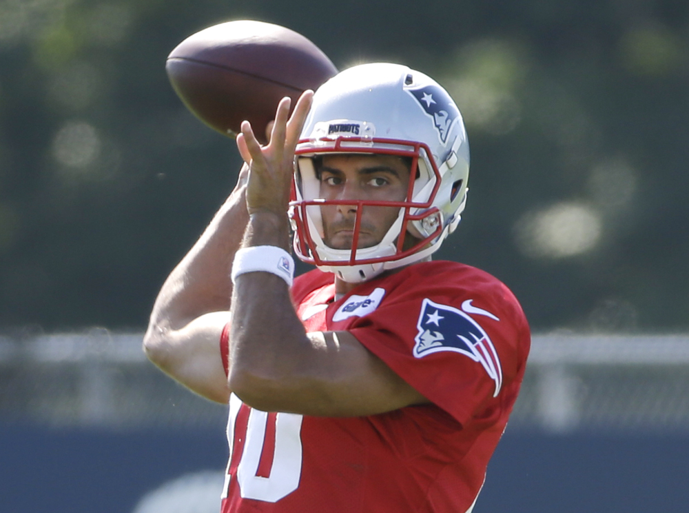 New England Patriots quarterback Jimmy Garoppolo throws a pass during training camp Tuesday in Foxborough, Massachusetts.