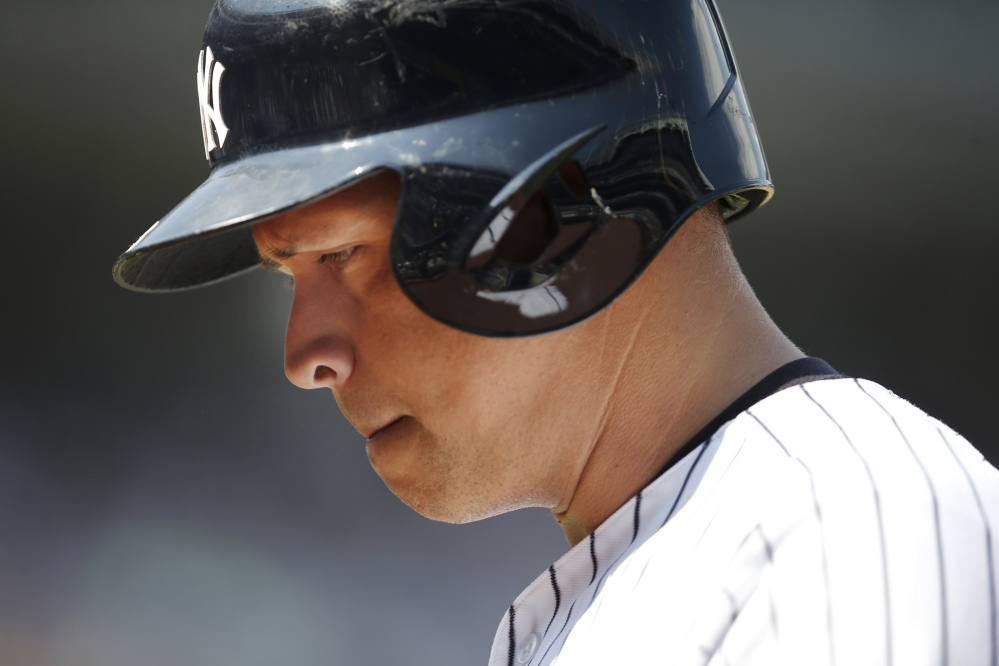 In this July 19, 2015 photo, New York Yankees designated hitter Alex Rodriguez returns to the dugout after popping out to third in a game against the Mariners at Yankee Stadium, in New York.