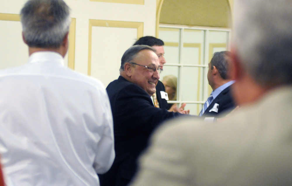 Gov. Paul LePage is greeted with a standing ovation by the members of the Kennebec Valley Chamber of Commerce before speaking to the group Wednesday in Augusta.