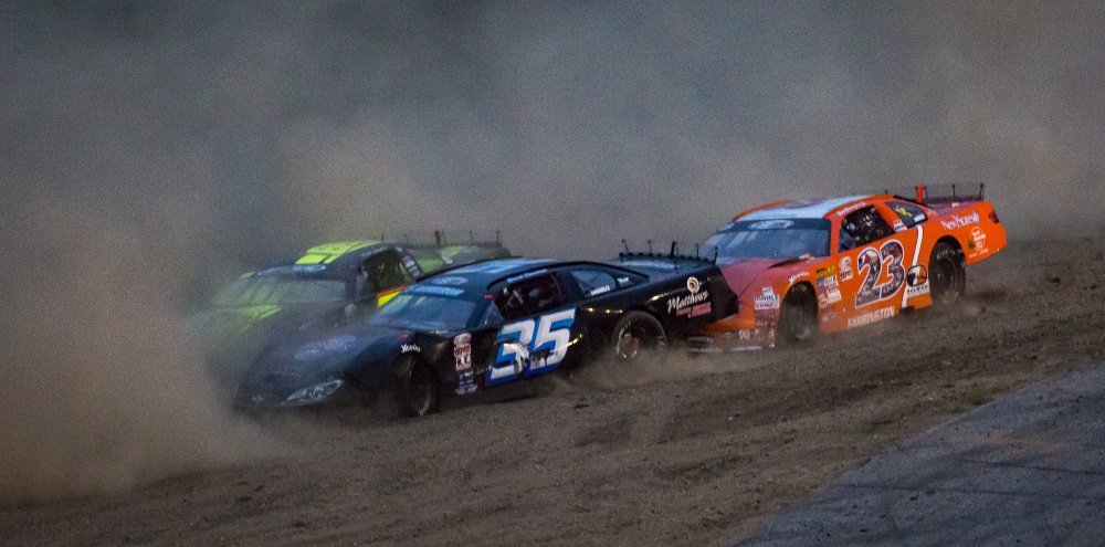 Cars kick up dust during a minor crash involving five cars during the Oxford 250. From left: Reid Lanpher, Derek Ramstrom and David Farrington.
