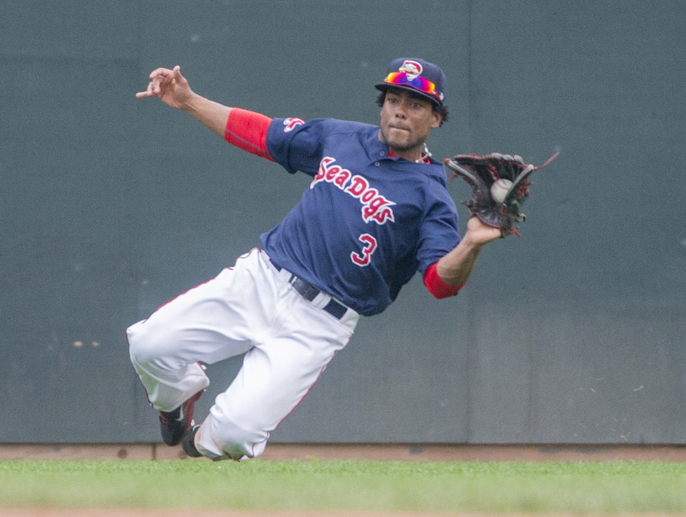 Sea Dogs outfielder Aneury Tavarez makes a sliding catch on a sinking liner against the Fisher Cats at Hadlock Field on July 26. Tavarez leads the Eastern League with a .330 average.