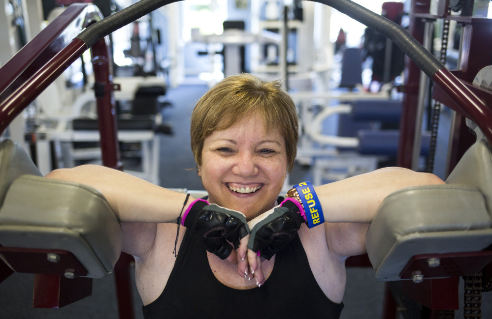 Charlene Ouellet of Brunswick, who is legally blind, takes a break at the gym where she trains. Ouellet, 53, is paying $21,000 for an experimental and controversial stem cell procedure by a doctor in Florida.