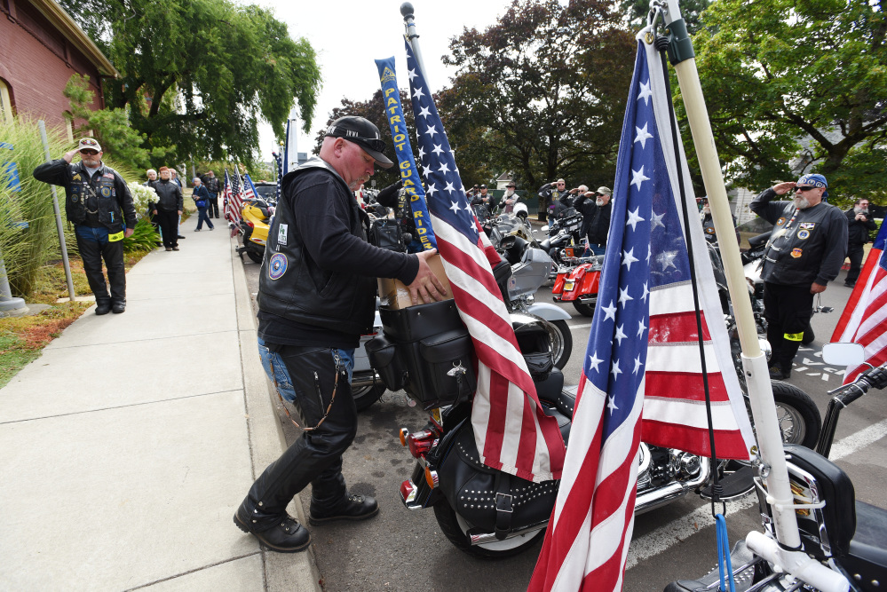 Patriot Guard Riders salute as the cremated remains of Maine Civil War soldier Jewett Williams are packed on a motorcycle following a ceremony Monday at Oregon State Hospital in Salem, Ore.