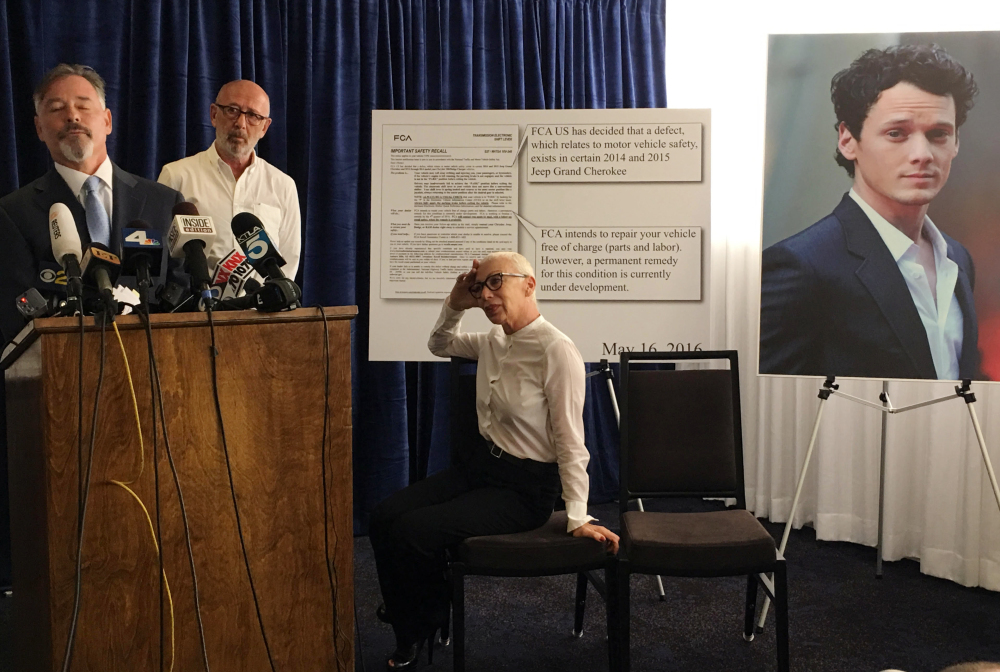 Attorney Gary Dordick, left, representing Victor and Irina Yelchin, parents of the late actor Anton Yelchin, talks to the media after filing a wrongful-death and product-liability lawsuit against Fiat Chrysler in Los Angeles Superior Court on Tuesday. Anton Yelchin, whose photo is posted at right, was crushed by his Jeep when it rolled backward down the driveway of his Los Angeles home June 19.