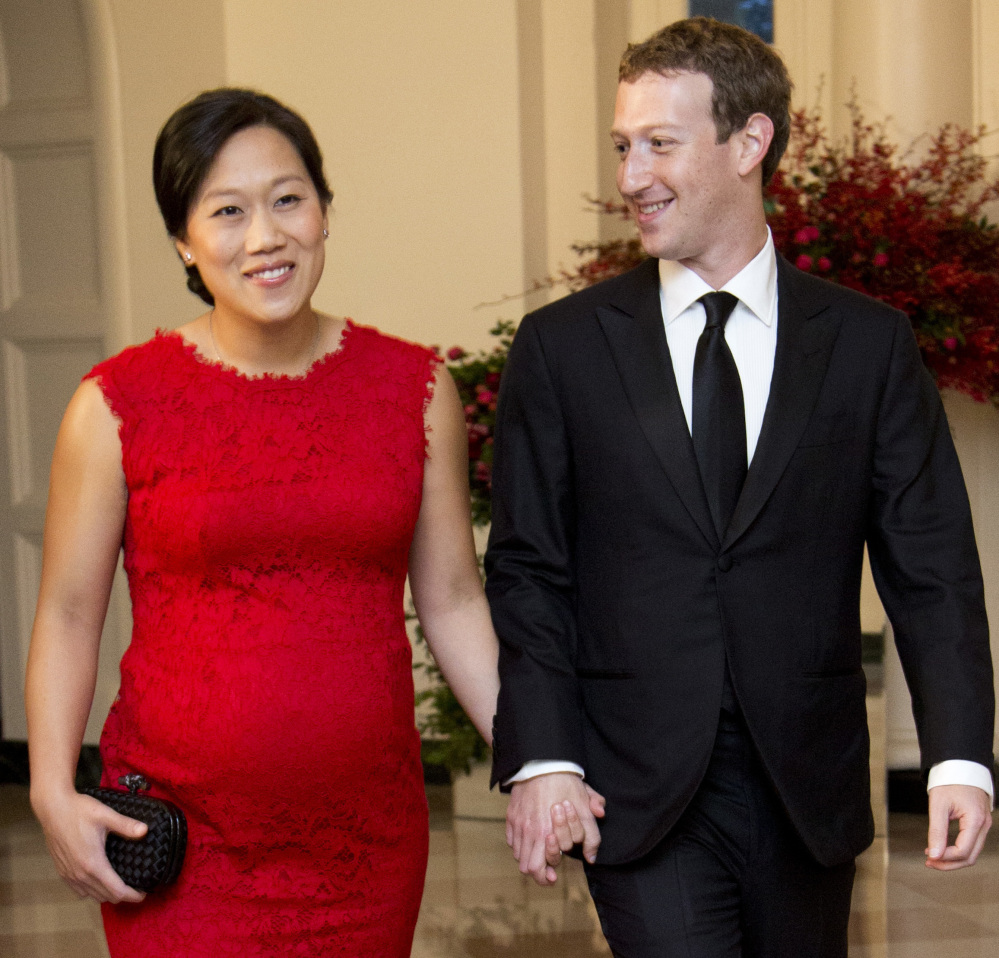 Facebook CEO Mark Zuckerberg, seen in 2015 with his wife, Priscilla Chan, offers 16 weeks of paid leave to new parents. Zuckerberg took two months off to care for his daughter.