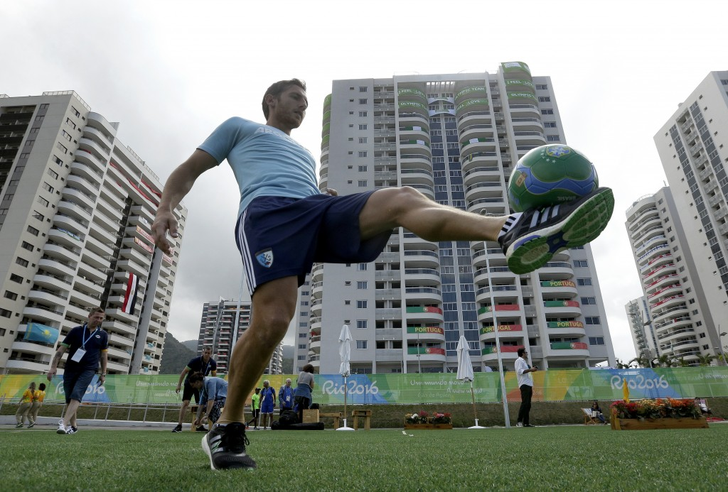 Argentine field hockey player Lucas Vila passes a soccer ball at the Olympic athletes village in Rio de Janeiro, Brazil, on Sunday. The Olympics are scheduled to open Aug. 5. (Associated Press/Charlie Riedel)