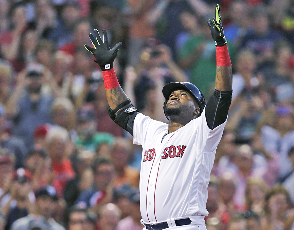 Red Sox designated hitter David Ortiz raises his arms as he crosses home plate after hitting a  three-run home run in a game against the Detroit Tigers last Tuesday. Charles Krupa/Associated Press