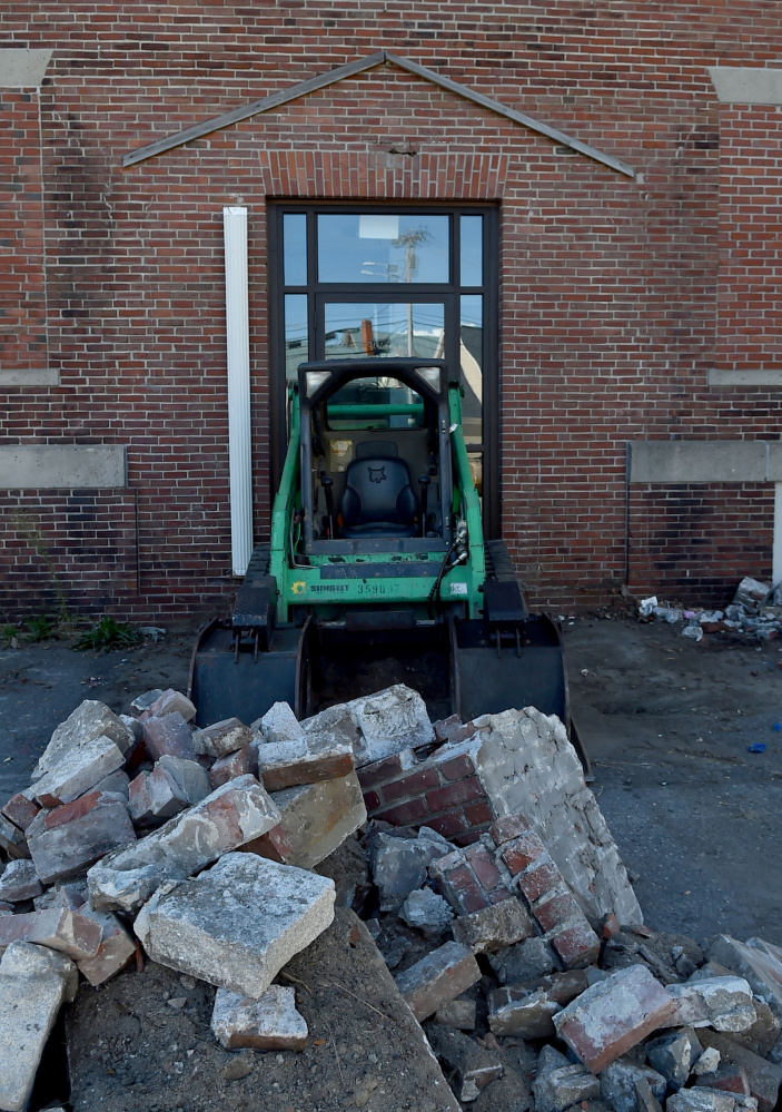 The former Elks building at 13-15 Appleton St. in Waterville, seen Friday, will be demolished soon and replaced by a parking lot as part of downtown revitalization efforts.