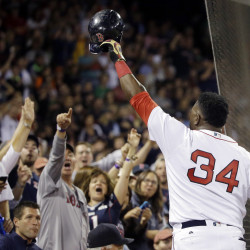 Boston Red Sox designated hitter David Ortiz tips his cap to cheering fans after hitting a solo home run against the Orioles in the sixth inning Monday in Boston.