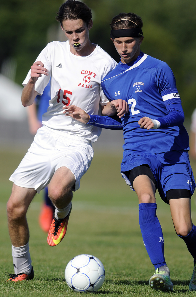 Cony's James Olivier, left, keeps the pressure on Messalonkee's Tanner Burton during a game Thursday in Augusta.