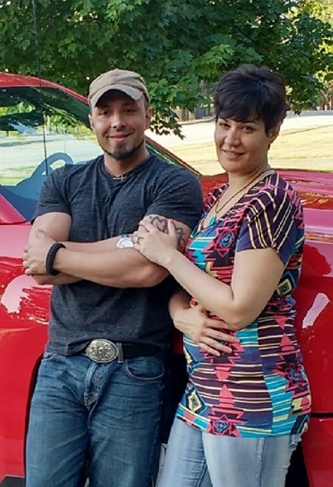 Valerie Tieman, right, is seen with her husband, Luc, in this July photo provided by police. Behind them is the truck she was last seen in Aug. 30 at a Wal-Mart parking lot in Skowhegan.