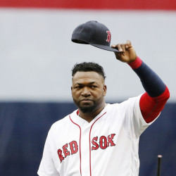 Boston's David Ortiz tips his cap to the crowd during ceremonies before Sunday's game at Fenway Park.