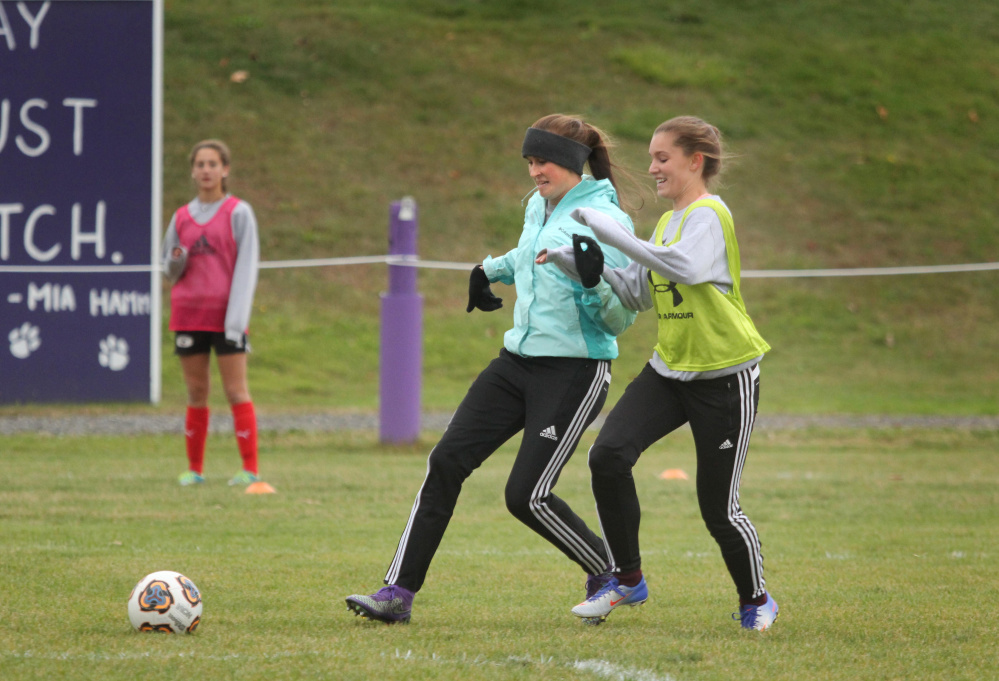 Waterville forward Sophie Webb and Sophie Anich, right, battle for the ball during practice on Monday.