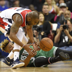 Boston's Marcus Smart, bottom, battles for the ball with Washington's Marcus Thornton in the first half Wednesday night in Washington.