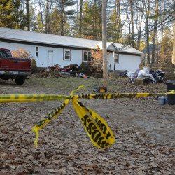 Sheriff's tape cordons off the house at 73 Songo School Road in Naples on Monday. Police say Richard Diekema was shot and killed early Sunday morning by Norman Strobel inside the two-bedroom mobile home.