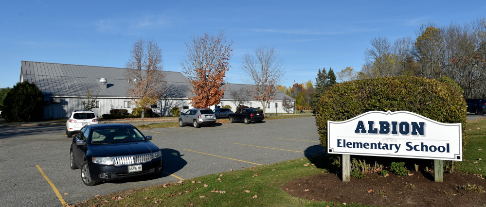 The future of Albion Elementary School is up for debate, with some school board members saying a new school should be built while others don't want the existing school closed.