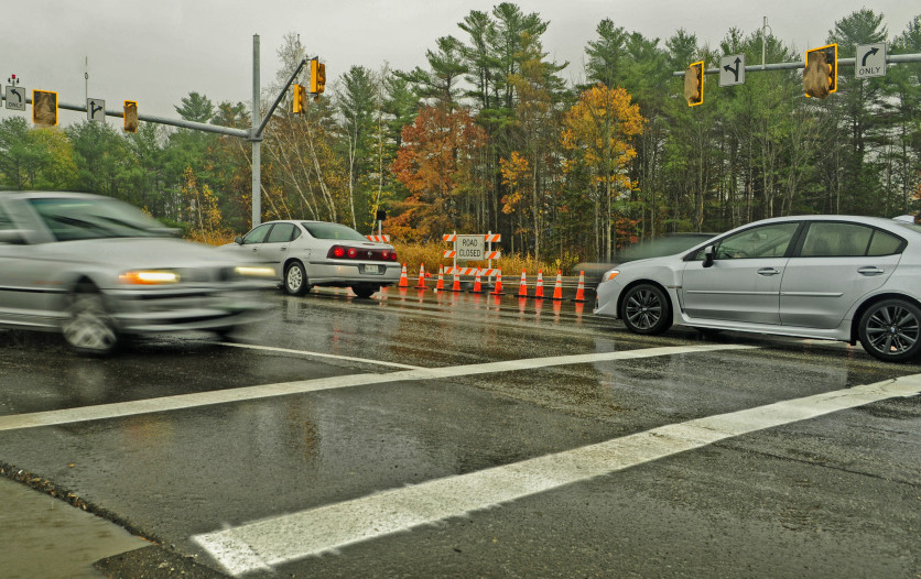 Vehicles drive through the intersection of Civic Center and Darin drives on Thursday in Augusta, where new traffic signals have been mounted but not yet activated.