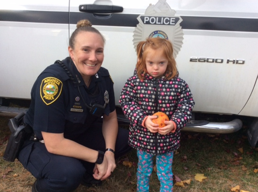 Iris Emond with pumpkin #3 with Officer Carly Wiggin.