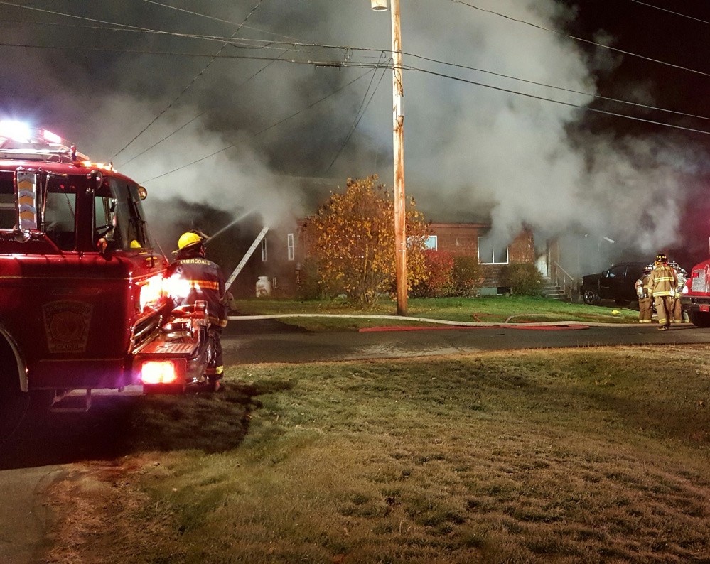 Firefighters work to contain a blaze at 39 Fairview Ave. in Randolph, which was destroyed by fire Saturday morning.