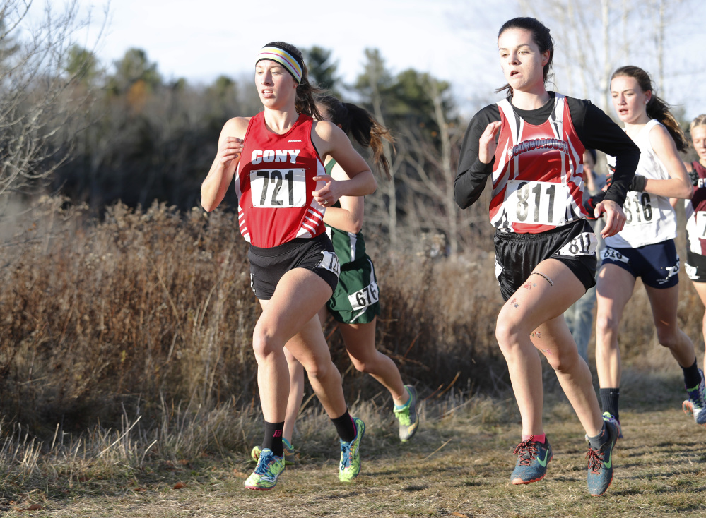 Cony's Anne Guadalupi, left, and Scarborough's Bethany Sholl, right, run during the Class A girls state championships Saturday in Belfast.
