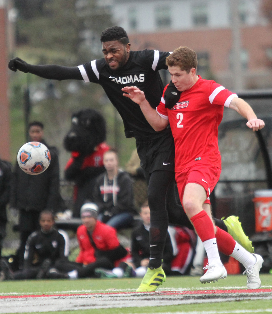 Thomas College's MacQuille Walker battles for the ball with New England College's Cooper Valinski in the first half of the North Atlantic Conference championship in Waterville on Saturday night.