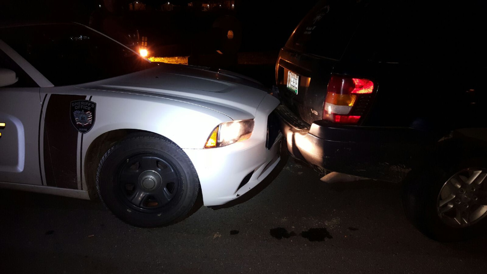 A 2004 Jeep driven by Nathan Rasmussen was moving down School Street on the wrong side of the road, leading to the man's arrest after he allegedly backed into a police cruiser and kicked an officer, according to the Waldo Count Sheriff's Office.