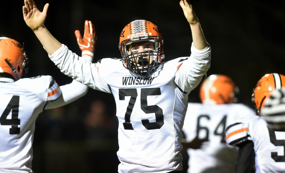 Winslow lineman Ben Abbott (75) celebrates a Ryan Gagnon quarterback sneak for a touchdown during a Big Ten Conference semifinal game Friday night at Rudman Field in Madison.