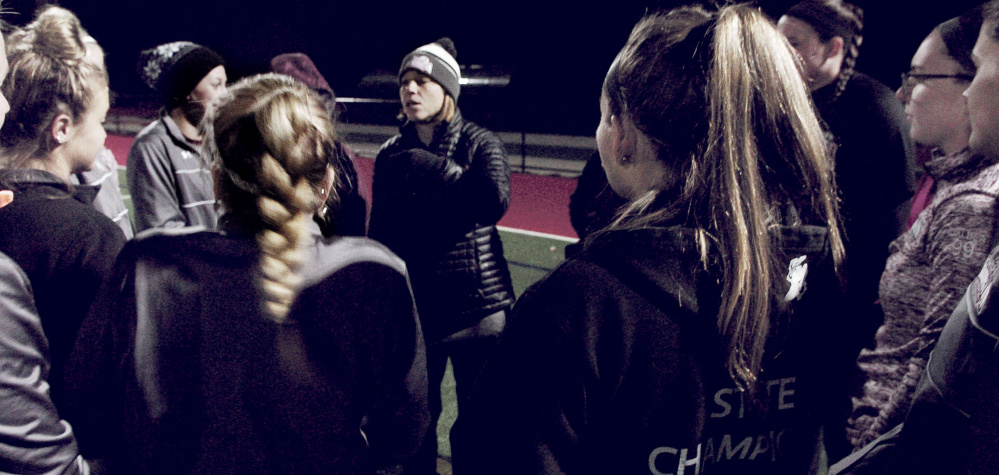 University of Maine at Farmington head field hockey coach Cyndi Pratt speaks with the team during practice Monday at Thomas College in Waterville.