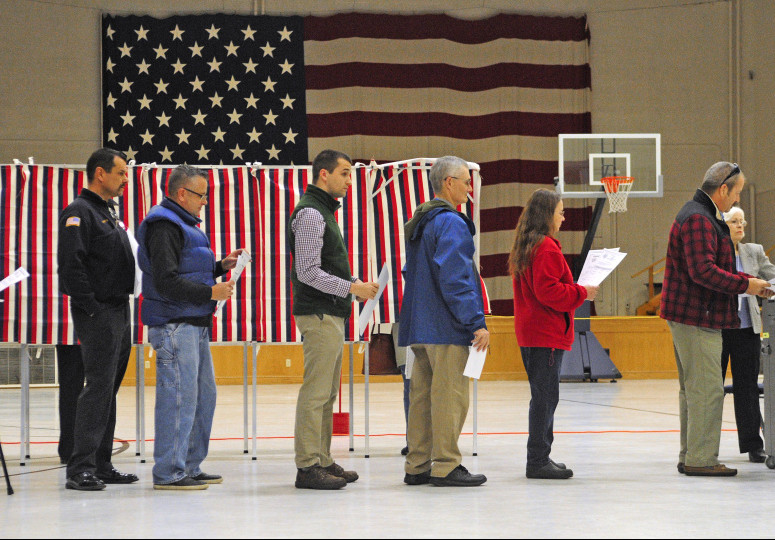 Voters wait in line to cast ballots around 7:10 a.m. Tuesday at the Ward 1 polling place in the Augusta State Armory.