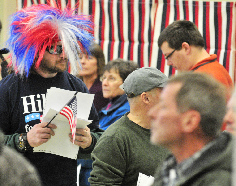 Israel Legassie waits in line to cast his ballot Tuesday while wearing a Hillary for Prison shirt and a red, white and blue wig at the Boys and Girls Club of Greater Gardiner.