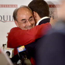 U.S. Rep. Bruce Poliquin hugs his son, Sam, at Dysart's Restaurant and Bakery in Bangor after beating Emily Cain in the 2nd District race on Tuesday.