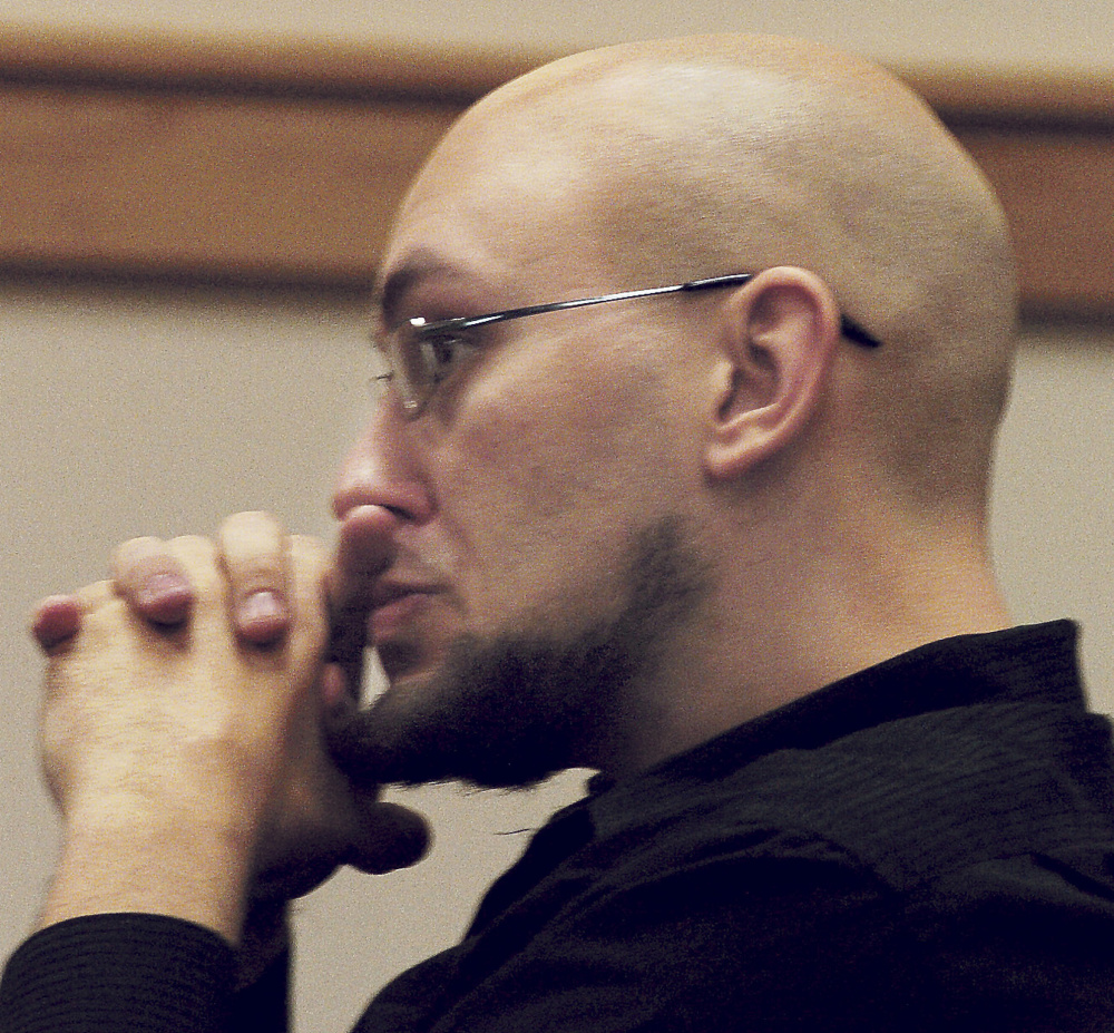 Zachary Casey listens to court proceedings during his arraignment Wednesday on class A arson in Skowhegan District Court.