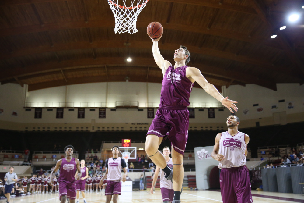 Nick Mayo, a Messalonskee graduate, goes to the hoop during an Eastern Kentucky practice. Mayo averaged 14.5 points, 4.9 rebounds and 1.1 blocks per game for the Colonels last season.