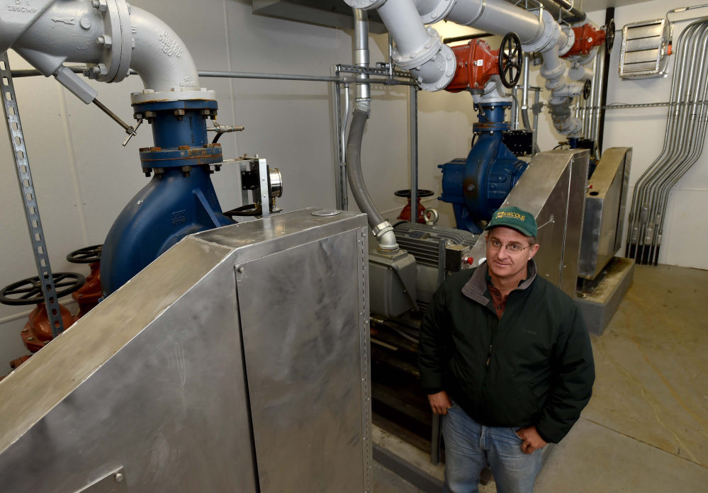 Boyd Snowden, superintendent of the Oakland Sewer District, poses Thursday next to sewer pumps at the town's Sewer Department.