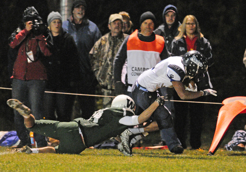 Winthrop's Bennett Brooks, left, tackles Dirogo's Hunter White during a Campbell Conference Class D semifinal game last Friday at Maxwell Field in Winthrop.