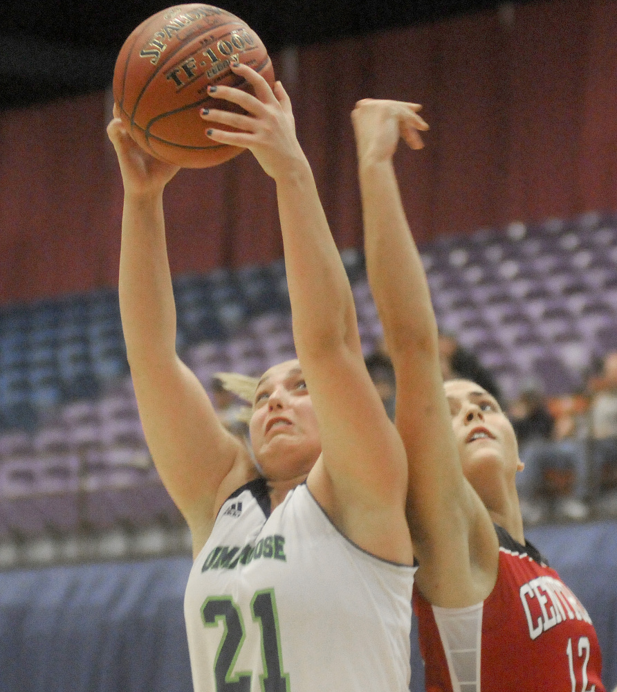 University of Maine at Augusta forward Caitlin LaFountain, left, snags a rebound away from Central Maine Community College's Brooke Reynolds during a game Thursday night at the Augusta Civic Center.