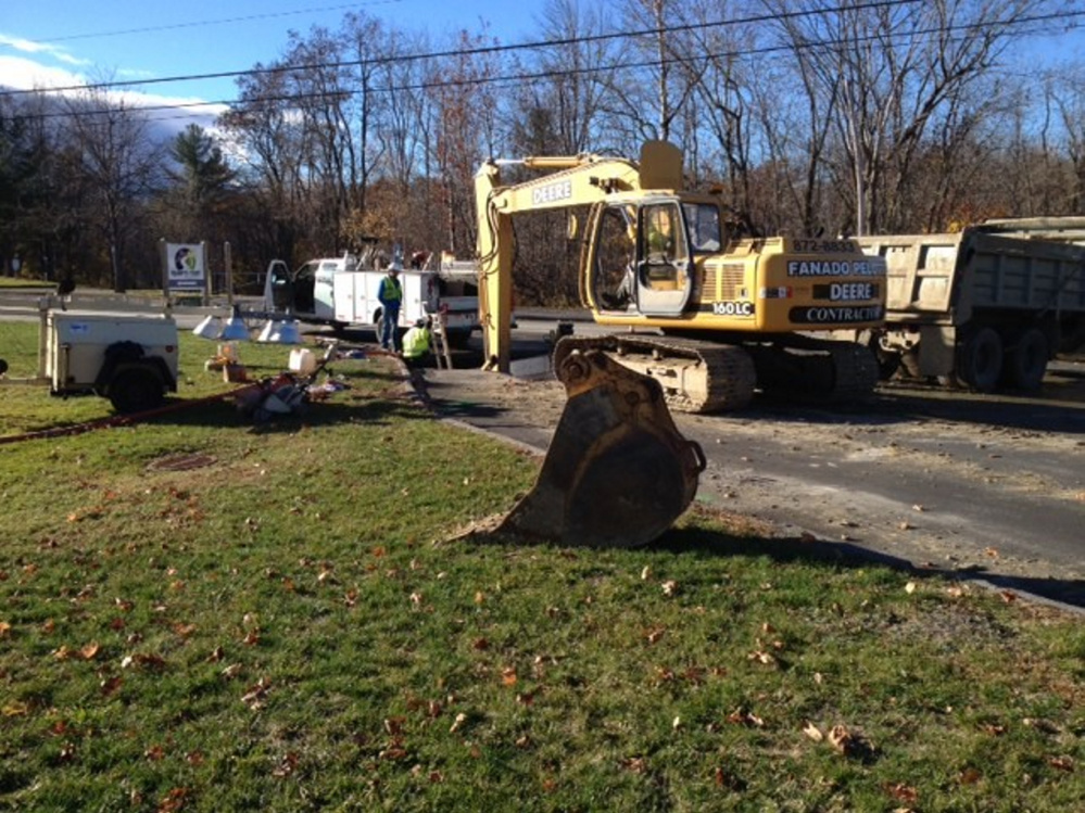 Kennebec Water District workers try to fix a broken water main Friday morning at the entrance to Quarry Road.
