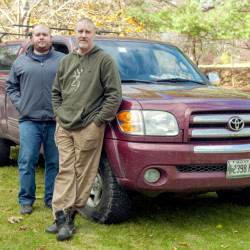 Standing beside the truck it happened in, Tom Robinson, left, of Litchfield, and Ron Greco, of Cumberland, tell the story of their recent run-in with a drunk driver near Jackman.