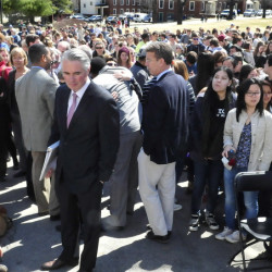 Colby College President David Greene, center, makes his way through more than 500 students and staff members on April 16, 2015, at the Waterville campus to speak during a forum on racial issues.