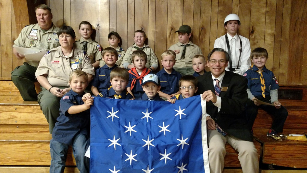 Jackman's Cub Scout Pack and Boy Scout Troop 497 gave a public presentation about Gen. George Washington during the Veterans Day ceremony on Nov. 10 at the Forest Hills School. It was the last requirement of the Scout Patriot Award. Scouts in the front, from left, are Remi Worster, Maddox Cuddy, Jacob Bennett, Xavior Ball and Chuck Mahaleris, Scouting Advancement chairman, of Augusta, displayed the Commander in Chief flag which was used whenever Gen. Washington was on the battlefield or at his headquarters such as Valley Forge. Middle row, from left, are Karla Talpey, Jaxon Desjardins, Matthew Hall, Brennan Begin, Rory Danforth and Vaughn Varney; and back, from left, are Alan Duplessis, Parker Desjardins, Tommy Sylvester, Robert Bouffard, Chris Someret and Hunter Cuddy.