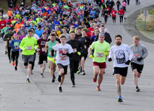 The pack comes around a curve just after starting the Gasping Gobbler 5k on Thursday at Cony High School in Augusta.