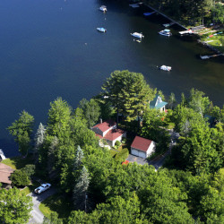 An aerial view captures the property's waterfront setting.