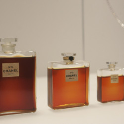 In this May 2, 2005 file photo, bottles of Chanel No. 5 perfume are displayed at the Metropolitan Museum of Art's Costume Institute exhibit in New York. Chanel is making a stink over a possible high-speed train line through jasmine fields in Provence, warning it could threaten production of its Chanel No. 5 perfume.