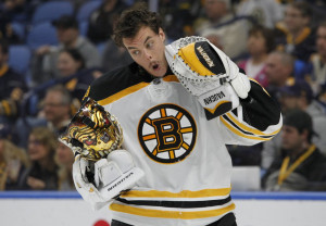 Boston goalie Tuukka Rask reacts after being hit with a high stick during the first period against Buffalo. Rask made 35 saves and lead to Bruins to a 2-1 win. (Associated Press/Jeffrey T. Barnes)
